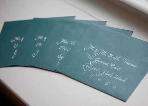 Bickham Script Calligraphy in White Ink on Teal Envelopes